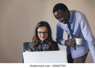Young Multi-Ethnic Couple Working at the Office.