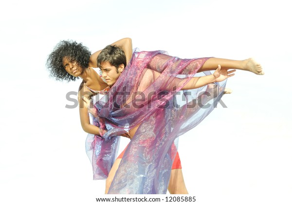 Young multiracial couple in artistic pose isolated
