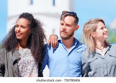 Young multiracial friends with arabic girl and Dutch people standing close to each other as part of diversity friendship and togetherness concept