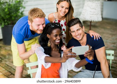 Young multiracial friends at cafe