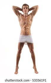 Young muscled male model posing in studio