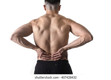 young muscular body sport man holding sore low back waist massaging with his hands suffering pain in athlete stress and health care concept isolated on white background