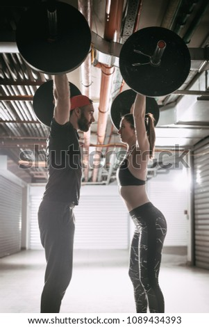 Young muscular couple doing snatch exercise stock photo edit now