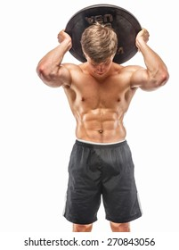 Young muscular guy holding weights. Isolated on white