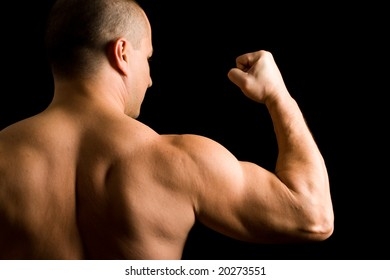 young muscular man flexing his arm