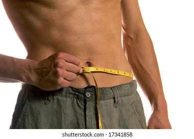 Young muscular man measuring his perfect body, isolated on white background
