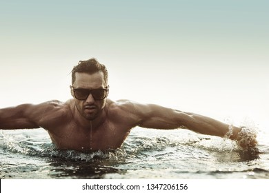 Young muscular man on a tropical vacation day