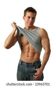 Young muscular man showing his abs isolated on white