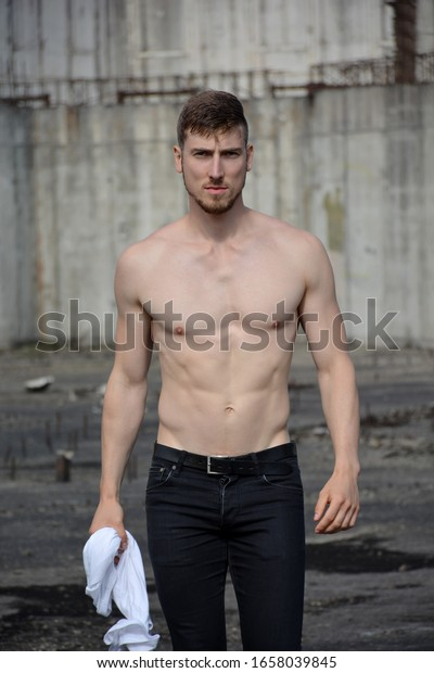 Young Muscular Man, Upper Body, Outdoors Posing, Looking At Camera, Shirtless. Bare Chest. Looking Forward.