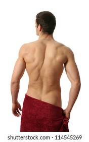 Young muscular man wrapped in a red towel isolated on white