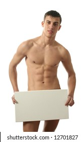Young muscular nude man covering a copy space blank billboard isolated on white