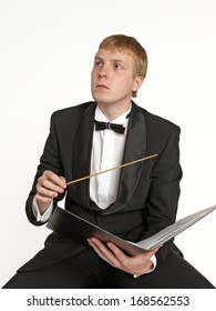Young music conductor with score and baton