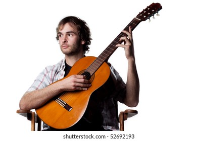 Young musician with a classic guitar, studio shot, white background