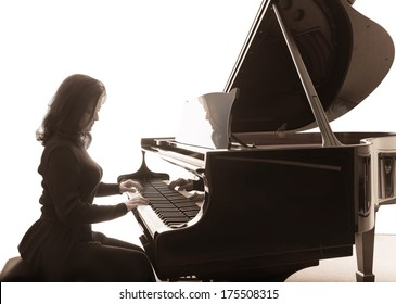Young musician plays the grand piano, square composition