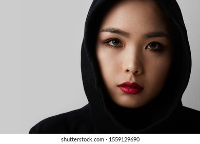 Young muslim asian woman posing on the white background. Isolated.