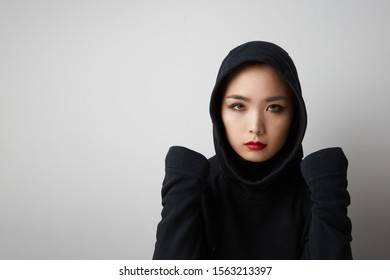 Young muslim asian woman posing on the white background. Isolated. Space for your text.