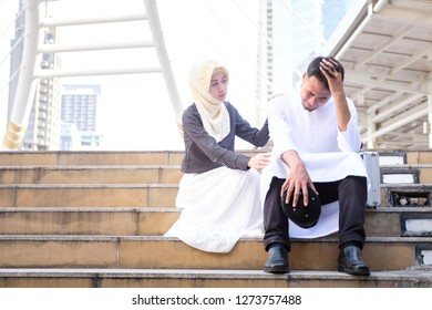 Young muslim business man consoling his colleagues, business people unsuccessful that feeling sad or hopeless, business man failed job, business unsuccessful concept