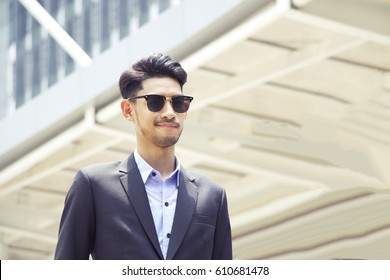 Young muslim business man is standing in the town