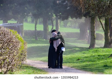 Young muslim couple demonstrating their affection in a public space. Thornton Reservoir, Leicestershire, England GB