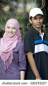 Young Muslim couple in happy smile action.