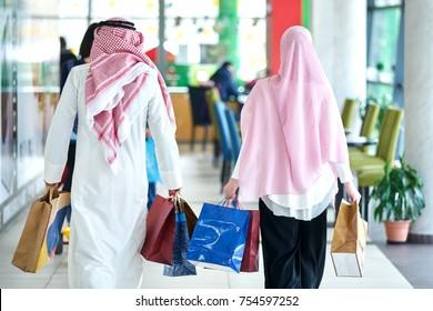 Young muslim couple shopping and having fun