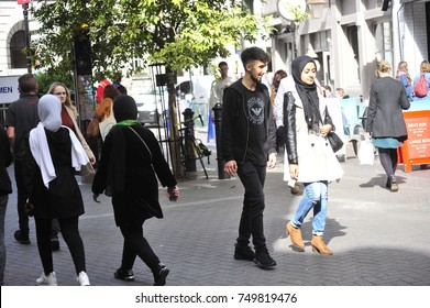 A young Muslim couple takes a stroll near St. Paul's Cathedral in London on 9/17/17