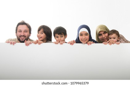 Young muslim family with white banner