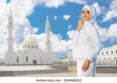 Young muslim girl on mosque background