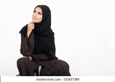 young muslim girl wearing traditional dress on white background