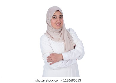Young muslim girl wearing a veil, standing crossed arms and smiling, isolated on white background