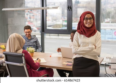 Young muslim hijab business woman in office, portrait