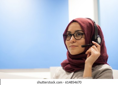 Young muslim hijab call center agent in office, portrait
