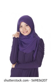 Young Muslim Malay teenage girl smile while posing