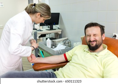 young muslim man donating his blood in hospital