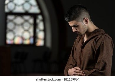 Young Muslim Man Praying - Guy Making Traditional Prayer To God While Wearing A Traditional Cap Djellaba