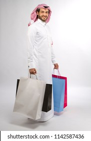 A young muslim man with shopping bags in hand in super market in mall in Saudi Arabia Middle east gulf