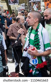 A young Muslim man speaks into a microphone calling for people to boycott Israel and support Palestine during the Al Quds Day rally, London, 10/06/18.