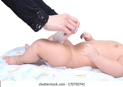 Young muslim mother changing the diaper of her baby isolated on white background