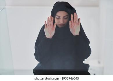 Young muslim woman doing sujud or sajdah