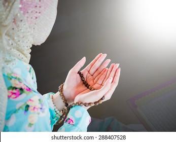 young muslim woman praying for Allah, muslim God