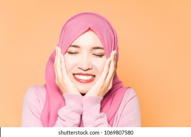 Young muslim woman wearing hijab.