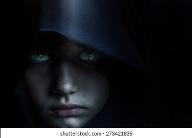 Young mysterious fantasy girl on black background.