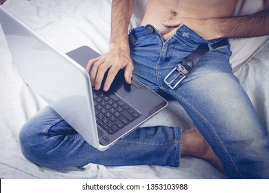 Young naked man watching pornography