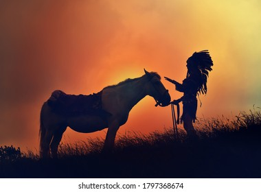 A young native American Indian woman is silhouetted with her horse in front of an evening sky. She stands with her horse in tall grass.