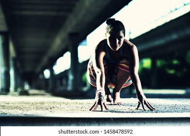 Young native american woman doing yoga on the street in summer.