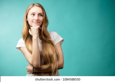 Young natural looking girl in different poses shows different emotions on blue backgrounds