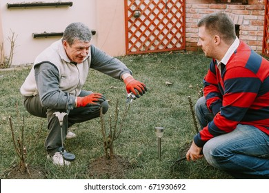 Young neighbour helps senior men with gardnering work around the house