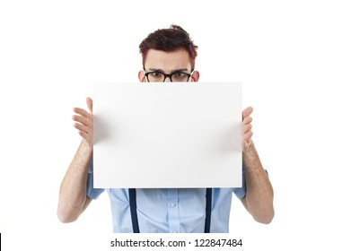 Young nerd man holding white panel