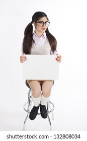 Young nerd woman holding white card