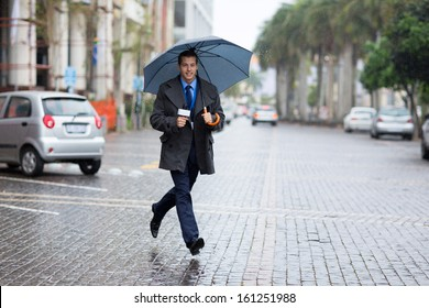 young news correspondent rushing for breaking news in raining day